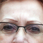 Permanent eyebrows and eyeliner along with glasses