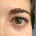 Emerald green permanent eyeliner on woman